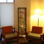 massage waiting room with chairs and products