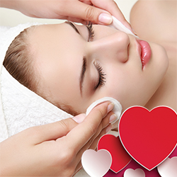 woman receiving facial with pink hearts in corner of image