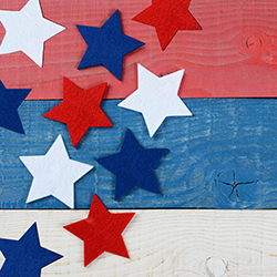 red white and blue stars on wood background