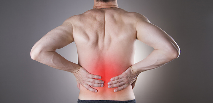 man holding back with red area indicating pain