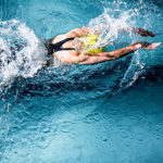 above view of woman swimming in pool