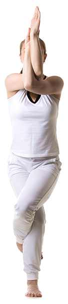 woman wearing white against white background in yoga eagle pose
