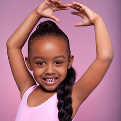 little girl in ballet outfit dancing