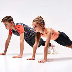 boy and girl doing a push up